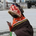 Tibetan lady and her mobile